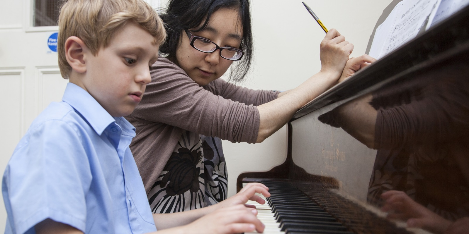 Boy Playing Piano with Maki.jpg
