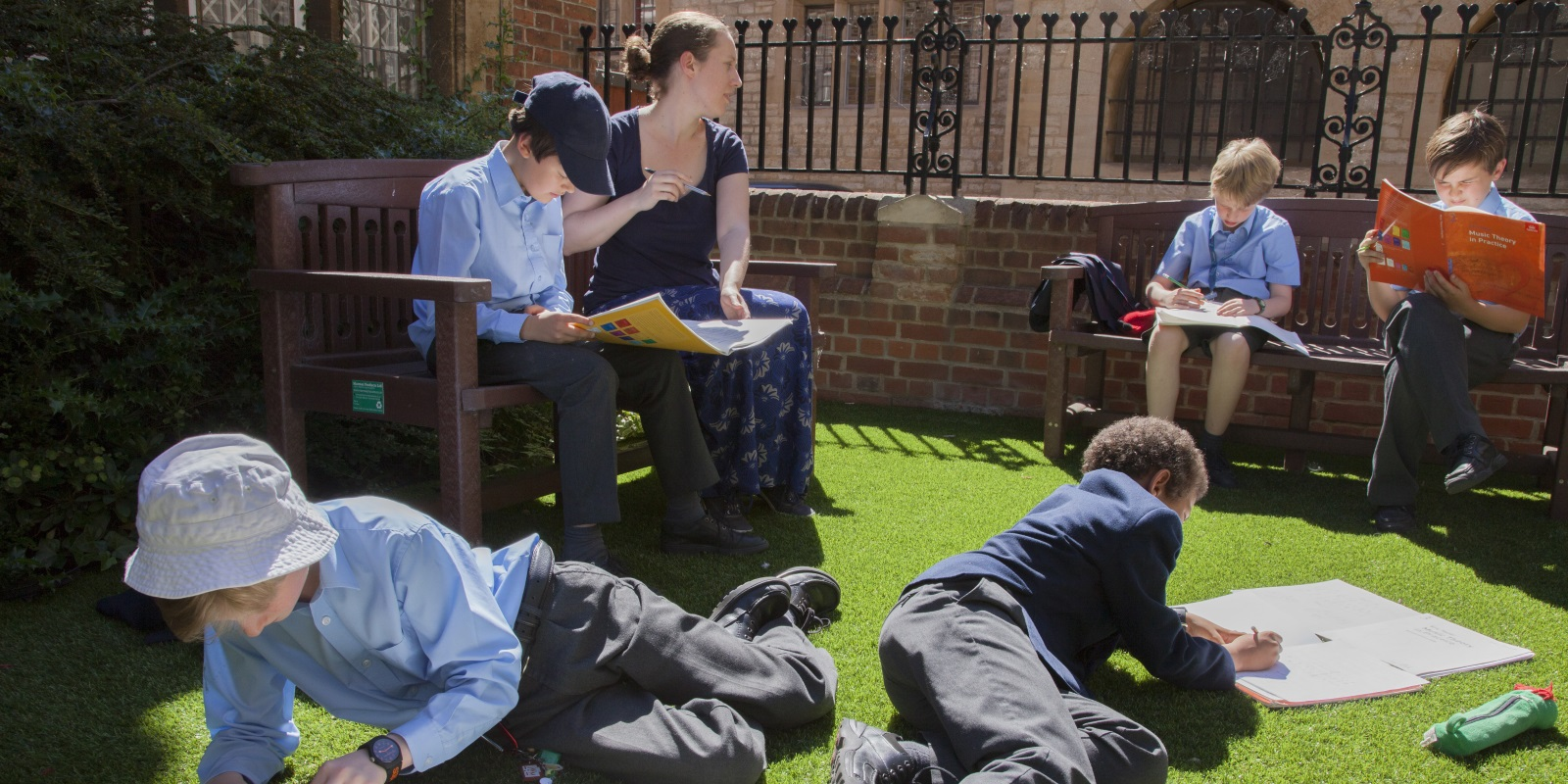 Miss Biddell with boys in garden.jpg
